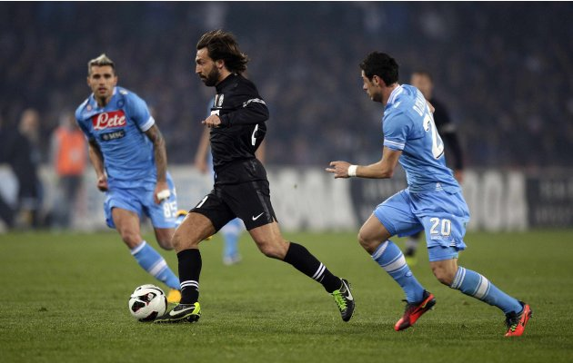 Napoli's Pirlo controls the ball as he is followed by Napoli's Dzemaili during their Italian Serie A soccer match at the San Paolo Stadium in Naples