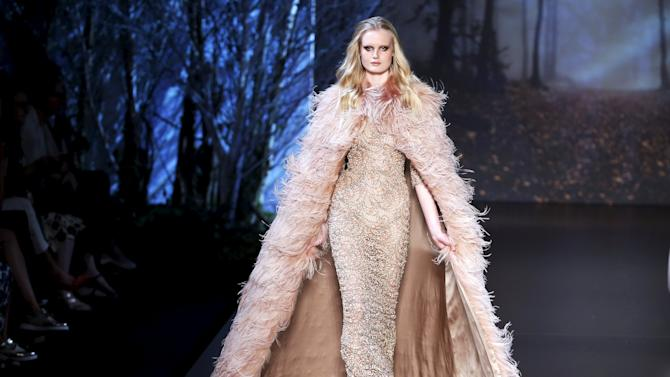A model presents a creation by Australian designers Tamara Ralph and Michael Russo as part of their Haute Couture Fall Winter 2015/2016 fashion show for British fashion house Ralph & Russo in Paris
