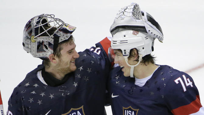 USA goaltender Jonathan Quick greets forward T.J. Oshie after Oshie scored the winning goal against Russia in a shootout during overtime of a men's ice hockey game at the 2014 Winter Olympics, Saturday, Feb. 15, 2014, in Sochi, Russia. (AP Photo/David J. Phillip )