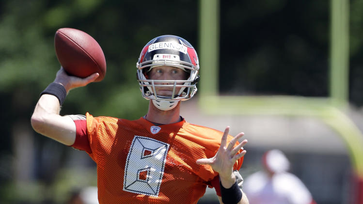 Tampa Bay Buccaneers quarterback Mike Glennon throws a pass during a voluntary minicamp NFL football practice Wednesday, April 23, 2014, in Tampa, Fla. (AP Photo/Chris O'Meara)