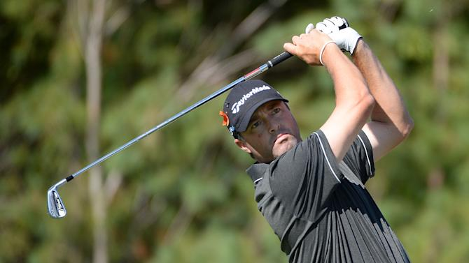 Ryan Palmer takes his shot on the third hole during the first round of the Deutsche Bank Championship in Norton, Massachusetts on August 29, 2014