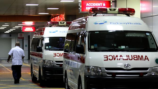 """Ambulances are parked outside the accident and emergency entrance at Mount Elizabeth Hospital in Singapore, late Friday Dec. 28, 2012. After 10 days at a New Delhi hospital, the victim of a gang-rape in New Delhi was flown to Singapore on Thursday for treatment at the Mount Elizabeth hospital. The young woman's condition had """"taken a turn for the worse"""" and her vital signs had deteriorated with indications of severe organ failure, said Dr. Kelvin Loh, the chief executive officer of Singapore's Mount Elizabeth hospital. (AP Photo/Wong Maye-E)"""