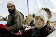 A girl waits for futher treatment at a Save the Children clinic after a 2005 earthquake in Batgram. Pakistan has ordered all Save the Children's foreign staff to leave the country within four weeks, in the wake of accusations linking the aid agency to a fake vaccination programme used in the hunt for Osama bin Laden