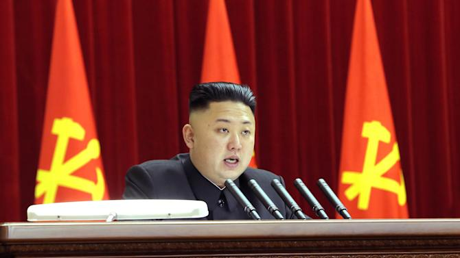 In this Sunday, March 31, 2013 photo released by the Korean Central News Agency (KCNA) and distributed in Tokyo Monday, April 1, 2013 by the Korea News Service, North Korean leader Kim Jong Un gives a speech during a plenary meeting of the central committee of the ruling Workers' Party in Pyongyang, North Korea. After weeks of war-like rhetoric, North Korean leader Kim gathered legislators Monday for an annual spring parliamentary session taking place one day after top party officials adopted a statement declaring building nuclear weapons and the economy the nation's top priorities. (AP Photo/KCNA via KNS) JAPAN OUT UNTIL 14 DAYS AFTER THE DAY OF TRANSMISSION