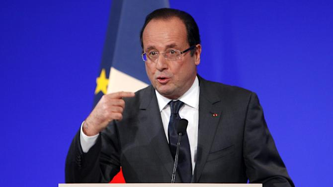 France's President Francois Hollande deliveers a speech during the inauguration of the Louvre Museum in Lens, northern France, Tuesday, Dec. 4, 2012. TThe museum in Lens is to open on Dec. 12, as part of a strategy to spread art beyond the traditional bastions of culture in Paris to new audiences in the provinces.(AP Photo/Michel Spingler, Pool)