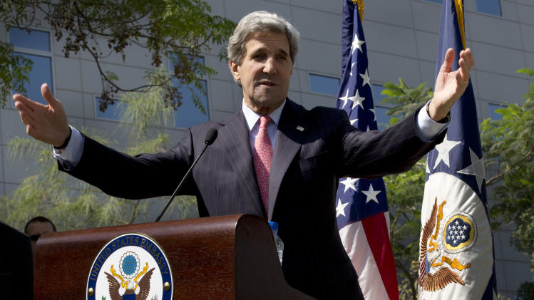 U.S. Secretary of State John Kerry speaks at the U.S. Embassy in Abu Dhabi, United Arab Emirates before leaving for the final destination of Qatar on his first official overseas trip as secretary of state, Tuesday, March 5, 2013. (AP Photo/Jacquelyn Martin, Pool)