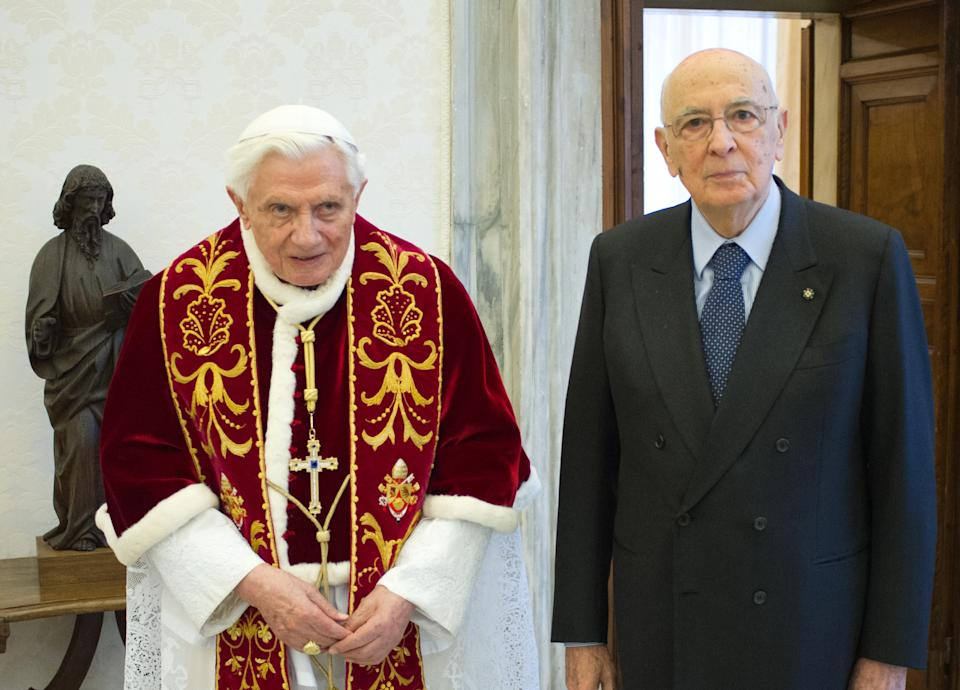 In this photo provided by the Vatican newspaper L'Osservatore Romano, Pope Benedict XVI, left, and Italian President Giorgio Napolitano pose for photographers on the occasion of their meeting, at the Vatican, Saturday, Feb. 23, 2013.  (AP Photo/L'Osservatore Romano, ho)
