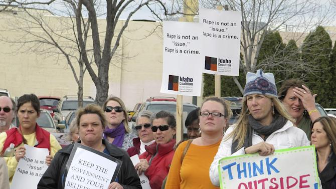 Protesters opposed to legislation requiring women seeking an abortion to undergo an ultrasound are shown demonstrating outside the Idaho Capitol in Boise on Wednesday, March 21, 2012. The protesters gathered while an anti-abortion group held a live ultrasound exhibition inside the building. (AP Photo/Jessie L. Bonner)