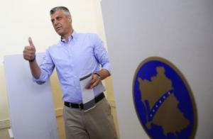 Kosovo's PM Thaci gestures at the polling station in Pristina