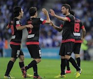 Atletico Madrid's Raul Garcia (R) is congratuled by his teammates during their Spanish League match against RCD Espanyol on September 30. Atletico host Czech club Viktoria Plzen, having comfortably beaten Israeli club Hapoel Tel-Aviv 3-0 in their Europa League opener