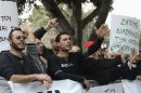 Protesters shout slogans during an anti-bailout rally by employees of Cyprus Popular Bank outside the parliament in Nicosia