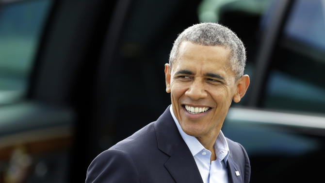 President Barack Obama smiles as he walks to Air Force One Saturday, Oct. 10, 2015, in San Francisco. Obama is on a four-day West Coast tour that includes democratic fundraisers along the way. (AP Photo/Ben Margot)
