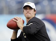 "FILE - This Aug. 30, 2012 file photo shows New Orleans Saints quarterback Drew Brees warming up before an NFL football preseason game between the Saints and the Tennessee Titans in Nashville, Tenn. The soda company, Pepsi, is partnering with the boy band, One Direction, and New Orleans Saints quarterback Drew Brees for an ad that will debut Wednesday. It's part of Pepsi's ""Live for Now"" campaign, which has also featured Nicki Minaj and Katy Perry. (AP Photo/Wade Payne, file)"