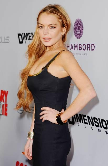 Lindsay Lohan arrives at the premiere of 'Scary Movie V' at ArcLight Cinemas Cinerama Dome on April 11, 2013 in Hollywood, Calif. -- Getty Premium