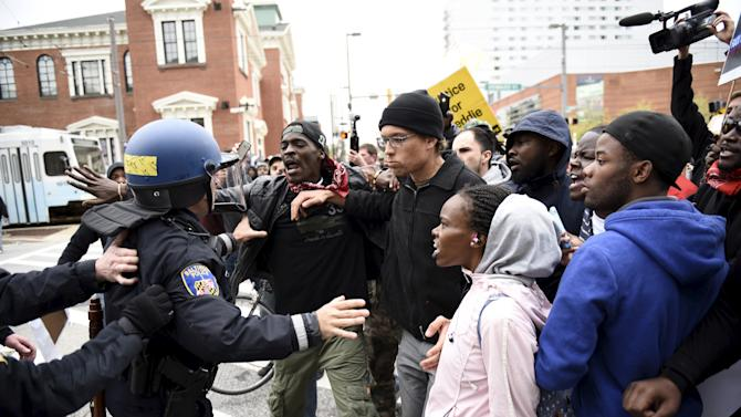 Police face demonstrators who gathered near Camden Yards to protest against the death in police custody of Freddie Gray in Baltimore