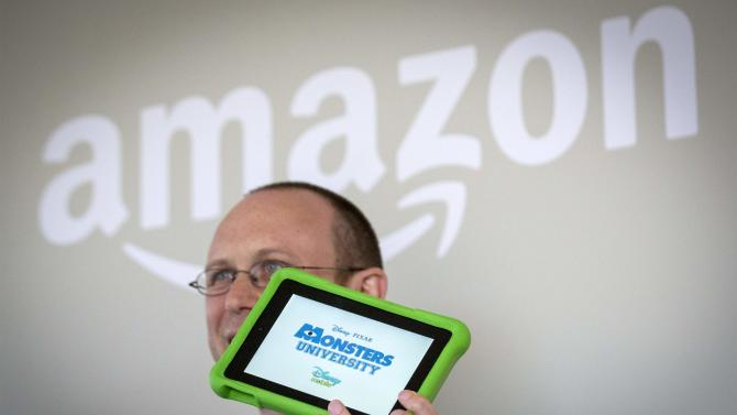Journalist shows the new Amazon Kindle Fire children's edition during a launch event in New York