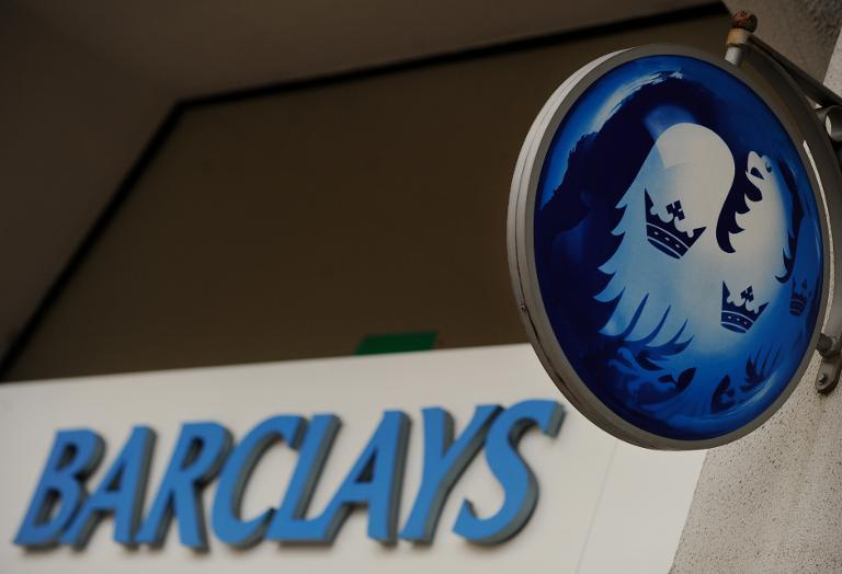 Barclays bank slides into annual net loss