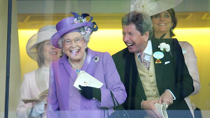 Britain's Queen Elizabeth II with her racing manager John Warren react after her horse, Estimate, won the Gold Cup on day three of the Royal Ascot meeting at Ascot Racecourse, England, Thursday June 20, 2013. (AP Photo / Tim Ireland/PA) UNITED KINGDOM OUT NO SALES NO ARCHIVE
