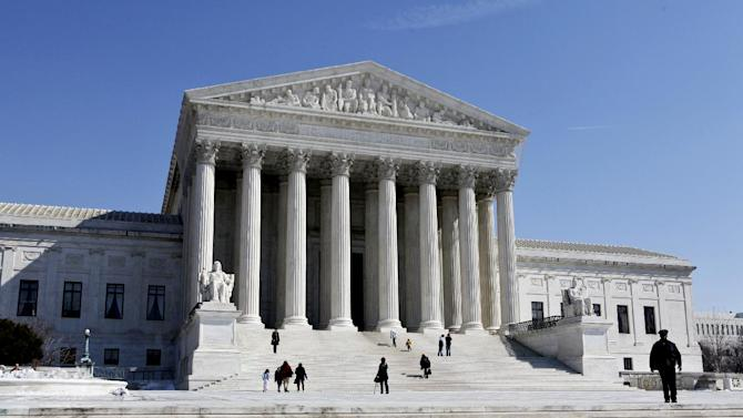 FILE- This March 5, 2009, file photo shows the U.S. Supreme Court building in Washington. The Supreme Court argued Monday, March 18, 2013 over whether states fighting voter fraud and illegal immigration can make people document their U.S. citizenship before allowing them to use a federal voter registration system that was designed to make it easier to vote.  (AP Photo/J. Scott Applewhite, File)