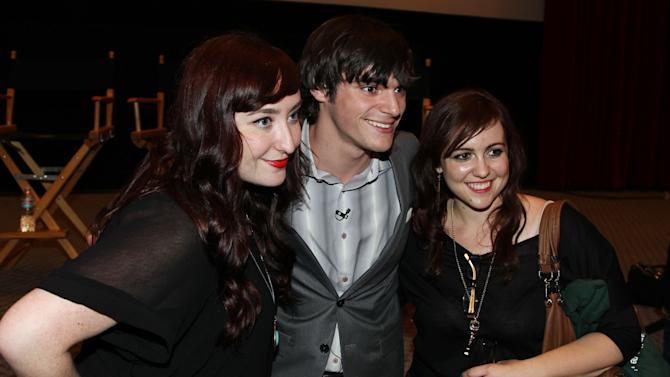 RJ Mitte, center, takes a picture with guests after AMC's Breaking Bad ATAS screening and panel at the Academy of Television Arts and Sciences on Saturday, April 13, 2013 in Los Angeles. (Photo by Matt Sayles/Invision for AMC/AP Images)