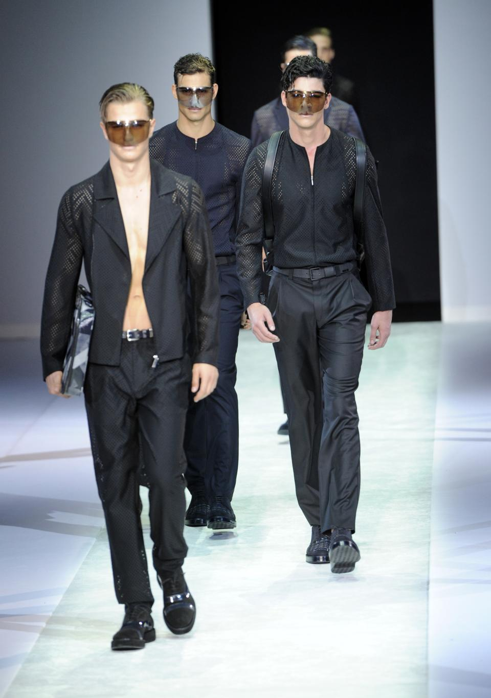 Models wear creations for Emporio Armani men's Spring-Summer 2014 collection part of the Milan Fashion Week, unveiled in Milan, Italy, Monday, June 24, 2013. (AP Photo/Giuseppe Aresu)
