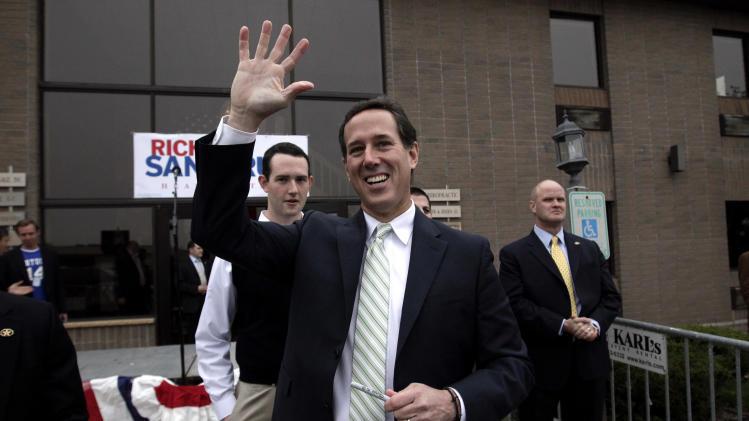 Republican presidential candidate, former Pennsylvania Sen. Rick Santorum waves as he visits the campaign headquarters in Brookfield, Wis., Saturday, March 31, 2012. (AP Photo/Jae C. Hong)