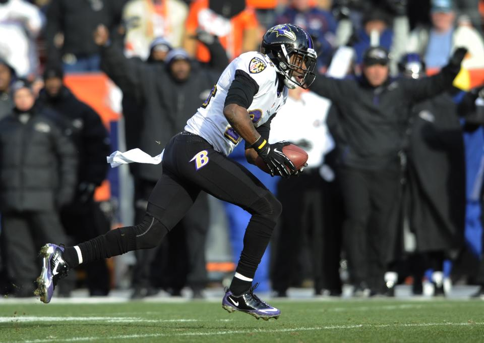 Baltimore Ravens cornerback Corey Graham runs an interception intended for Denver Broncos wide receiver Eric Decker back for a touchdown in the first quarter of an AFC divisional playoff NFL football game, Saturday, Jan. 12, 2013, in Denver. (AP Photo/Jack Dempsey)