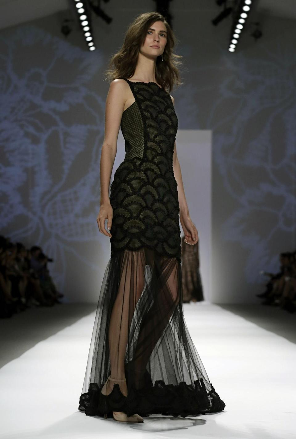 The Tadashi Shoji Spring 2014 collection is modeled during Fashion Week in New York, Thursday, Sept. 5, 2013. (AP Photo/Richard Drew)