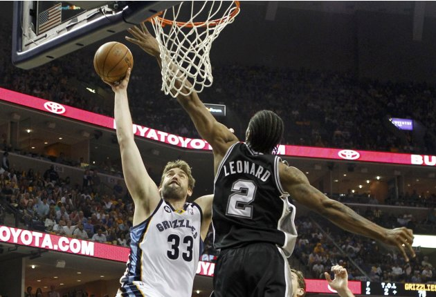 Grizzlies' Gasol drives to dunk over Spurs' Leonard during the fourth quarter in Game 3 of their NBA Western Conference final playoff basketball series in Memphis