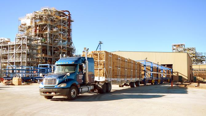 In this photo 2014 photo provided by Abengoa, a load of biomass, agricultural crop residues, is delivered to Abengoa's biorefinery in Hugoton, Kan. The plant, built by Seville, Spain-based Abengoa, is the largest cellulosic biorefinery in the world, producing up to 25 million gallons of ethanol fueled by non-edible waste. The Hugoton cellulosic ethanol refinery was funded in part by a loan guarantee from the Department of Energy. The same program funded high profile flops like Solyndra, the California-based solar company that filed for bankruptcy and led to hearings over the Barack Obama administration's backing of unproven green-energy projects.(AP Photo/Courtesy Abengoa)
