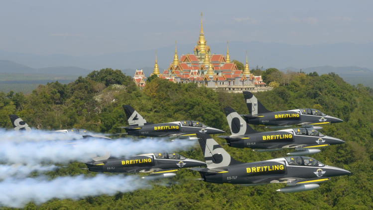 DISTRIBUTED FOR BREITLING - The Breitling Jet Team fly in formation past the Wat Tang Sai Temple on Thongchai Mountain near Ban Krud Beach in Southern Thailand on Tuesday, March 19, 2013. The team were repositioning from Malaysia to Thailand which is the fifth and final destination for the first phase of their Breitling Asian Tour. The ambassadors for the Swiss luxury watch company Breitling, will be based in China for 2013 and are due to visit Korea and Japan before returning to their home base in Europe. (Katsuhiko Tokunaga for Breitling via AP Images)