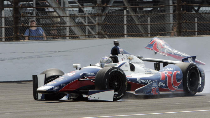 Marco Andretti slides after making contact with the first turn wall during IndyCar's Indianapolis 500 auto race at Indianapolis Motor Speedway in Indianapolis, Sunday, May 27, 2012. (AP Photo/Joe Watts)