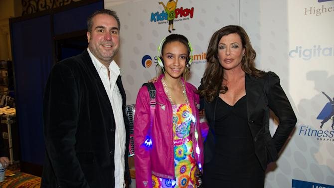 IMAGE DISTRIBUTED FOR CRA-Z-ART - From left, Tom Ortel, Jaliyah Harris wearing a twinkling Lite Brix ensemble by Cra-Z-Art and actress, Kelly LeBrock at the International CES FashionWares fashion show at the Venetian Ballroom inside the Venetian resort and casino on Thursday, Jan. 10, 2013, in Las Vegas, NV. (Photo by Al Powers/Powers Imagery/Invision for CRA-Z-ART/AP Images)