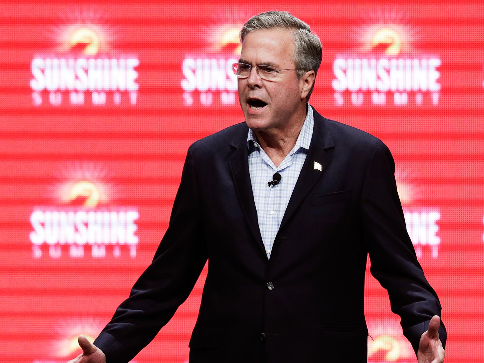 Jeb Bush is spitting fire at Obama for touting climate-change efforts after Paris attacks