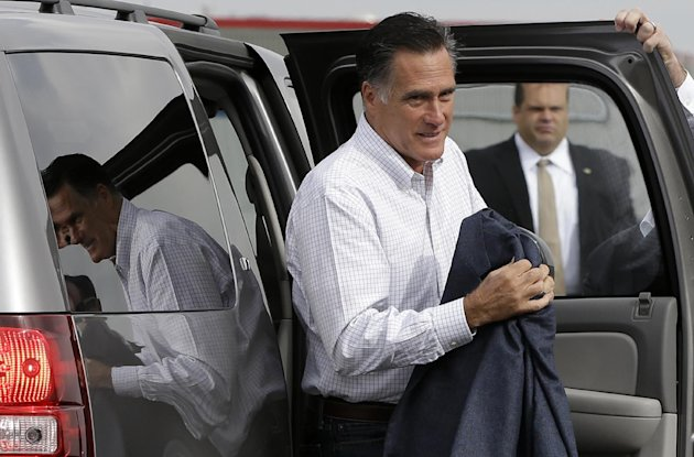 Republican presidential candidate, former Massachusetts Gov. Mitt Romney gets out of his vehicle before sitting down for television interviews at the airport in Denver, Monday, Sept. 24, 2012. (AP Photo/Charles Dharapak)
