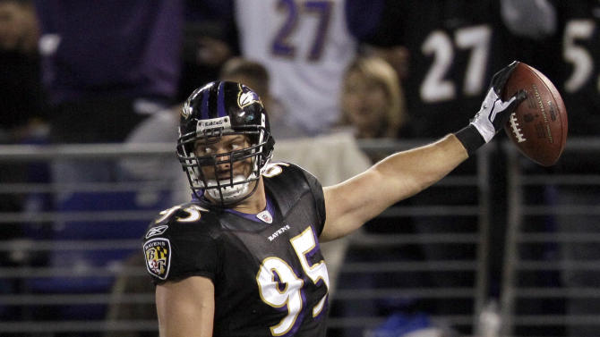 Baltimore Ravens outside linebacker Jarret Johnson celebrates his touchdown in the end zone during the first half of an NFL football game against the New York Jets in Baltimore, Sunday, Oct. 2, 2011. (AP Photo/Patrick Semansky)