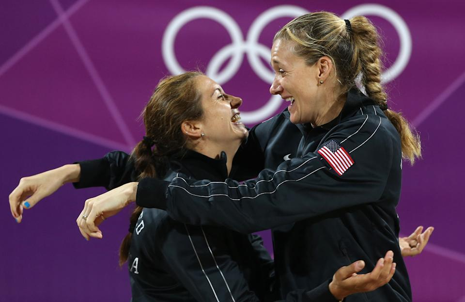 United States' Kerri Walsh Jennings, right, and Misty May-Treanor, left, hug during a podium ceremony after winning the women's gold medal beach volleyball match at the 2012 Summer Olympics, Wednesday, Aug. 8, 2012, in London. (AP Photo/Petr David Josek)