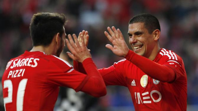 "Benfica's ""Maxi"" Pereira celebrates his goal against Boavista with team mate ""Pizzi"" during their Portuguese Premier League match in Lisbon"