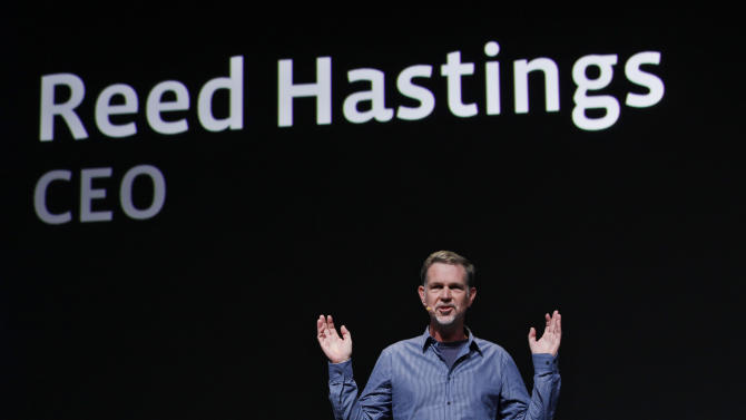 FILE - In this Sept. 22, 2011 file photo, Netflix CEO Reed Hastings gestures during the Facebook f/8 conference in San Francisco. Hastings said Monday, Oct. 10, 2011, it's abandoning its widely panned decision to separate its DVD-by-mail and Internet streaming accounts. (AP Photo/Paul Sakuma, File)