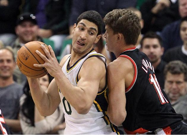 Portland Trail Blazers' Meyers Leonard (11) defends Utah Jazz's Enes Kanter (0) in the first quarter of an NBA preseason basketball game Wednesday, Oct. 16, 2013, in Salt Lake City