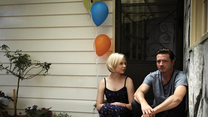 "This publicity image released by the Sundance Channel shows Adelaide Clemens, left, and Aden Young in a scene from the drama series ""Rectify."" The six-hour miniseries, whose first two hours air on Sundance Channel on Monday at 9 p.m., tells a unique story about a man who was caged for two decades for the rape and murder of his teenage girlfriend. Then, when his conviction is vacated thanks to new DNA evidence, he is restored to an outside world that proves just as harrowing. (AP Photo/Sundance Channel)"