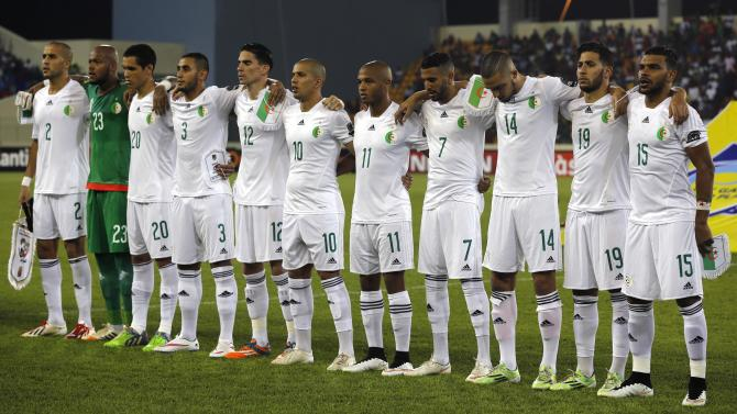 Algeria's national soccer team players listen to their national anthem before their quarter-final soccer match of the 2015 African Cup of Nations against Ivory Coast in Malabo