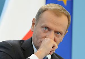 Polish Prime Minister Donald Tusk listens to a question …