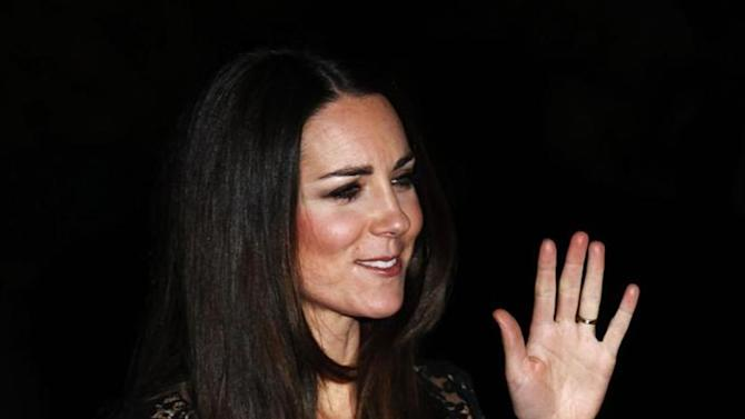 """Catherine, the Duchess of Cambridge, arrives for a screening of """"David Attenborough's Natural History Museum Alive 3D"""" at the Natural History Museum in London December 11, 2013. REUTERS/Luke MacGregor"""