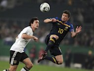 This file photo shows Australia&#39;s forward Harry Kewell (R) fighting for the ball with Germany&#39;s defender Mats Hummels during their friendly international in the western German city of Moenchengladbach, in 2011. Former Liverpool and Leeds United star Kewell has been voted Australia&#39;s greatest ever footballer
