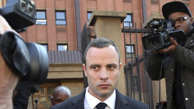 File: In this Tuesday May, 20, 2014, file photo Oscar Pistorius outide the HIgh Court in Pretoria, South Africa. Presiding Judge Thokozile Masipa is expected to announce her verdict in Pistorius' murder trail after scrutinizing evidence Thursday and Friday given by 37 witnesses in a court transcript running to thousands of pages in a drama that has played out over six months. (AP Photo/Themba Hadebe, File)