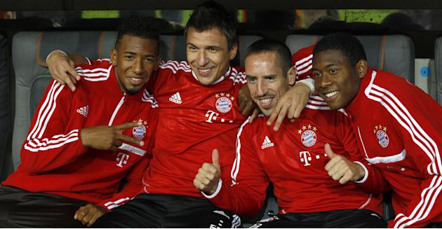 Munich's Jerome Boateng, from left, Mario Mandzukic of Croatia, Franck Ribery of France and David Alaba of Austria pose for media  prior to the German soccer cup second round match between FC Bayern M
