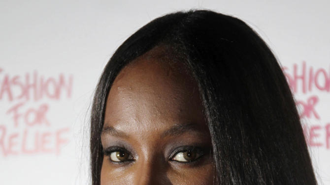 FILE- In this Thursday, Aug. 9, 2012 file photo, British model Naomi Campbell arrives for a Fashion For Relief dinner at Downtown restaurant in central London, Thursday, Aug 9, 2012. Model Naomi Campbell accepted libel damages Thursday, Jan. 31, 2013,  from a British newspaper over a story that falsely claimed she was planning an elephant polo match in India for her partner's birthday. The November article in the Daily Telegraph said Campbell was going to organize the tournament in Jodhpur for partner Vladimir Doronin's 50th birthday. The article included criticisms from animal-welfare activists. (AP Photo/Joel Ryan, File )