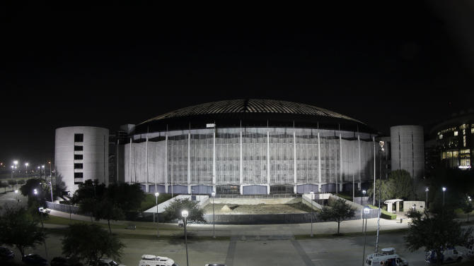 FILE- In this Tuesday, Nov. 5, 2013 file photo, the Houston Astrodome is illuminated, in Houston. Voters rejected what county officials had touted as the only way to save the prized dome from demolition. Still, this might not be the dome's last inning. (AP Photo/David J. Phillip, File)