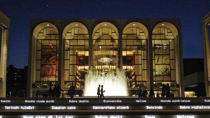 FILE - This May 20, 2010, file photo shows the Metropolitan Opera House at Lincoln Center for the Performing Arts in New York. The Metropolitan Opera is cutting ticket prices by an average of about 10 percent next season, when music director James Levine returns from a spine injury that led to a two-year absence. The Met said Tuesday, Feb. 26, 2013, more than 2,000 of its 3,800 seats will have lower prices next season and its average ticket price will drop from $174 to $156. There will be a minimum 15 percent discount for evening subscriptions and 10 percent for Saturday matinees.  (AP Photo/Henny Ray Abrams, File)